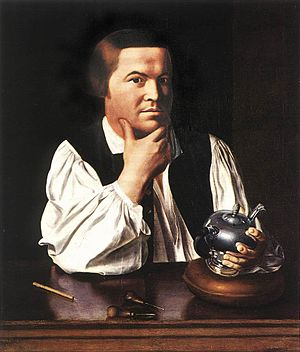Silversmith - Paul Revere with a silver teapot and some of his engraving tools.