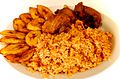 Jollof rice with fried fish and fried plantain.jpg