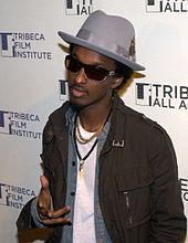 Musician taking a photo at Tribeca Film Festival in 2010