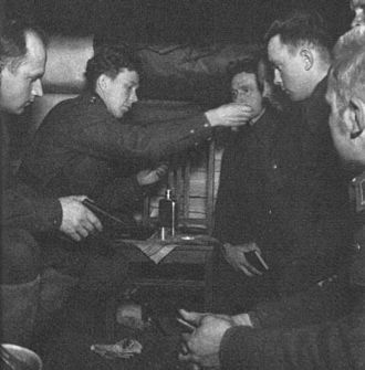 Evangelical Lutheran Church of Finland - A Finnish military chaplain administering Holy Communion during the Second World War. The shared experience of battle shaped the Church and the society for decades and affected the stance of the Church in social policy strongly.
