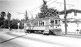 Unit #1407, one of 250 streetcars built for the LARy by the St. Louis Car Company, turns up Marmion Way. The air-operated folding doors were added in the 1930s to permit one-man operation.