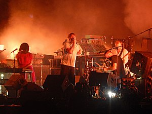 The band performing on stage