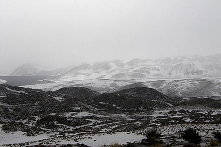 The snow covered collapse deposit Lac Chungara Chili.jpg