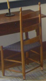 Ladder chair with brass swivel.png
