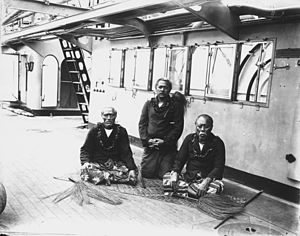 Lauaki Namulauulu Mamoe - Lauati (left) and two ''matai'' chiefs aboard the German warship, 1909. All three bear the symbols of matai orator status – the fue (fly whisk made of organic sennit rope with a wooden handle).