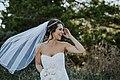 Laughing bride with blowing veil (Unsplash).jpg