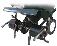 Core Lawn Aerator Attachment On A Conventional Front Tine Garden Tiller