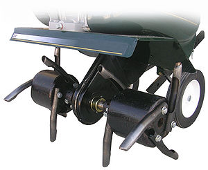 Lawn aerator - Core lawn aerator attachment on a conventional front-tine garden tiller