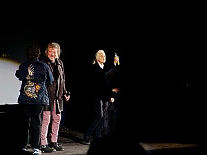 Dick Carruthers - Led Zeppelin being welcomed to the stage by Dick Carruthers to talk to press about the film Celebration Day at its premiere at the Hammersmith Apollo in London
