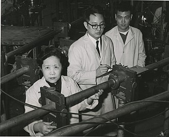 Chien-Shiung Wu - The experiments of Columbia University physicists (left to right) Wu, Y.K. Lee, and L.W. Mo confirmed the theory of conservation of vector current. In the experiments, which took several months to complete, proton beams from Columbia's Van de Graaff accelerator were transmitted through pipes to strike a 2 mm boron target at the entrance to a spectrometer chamber.