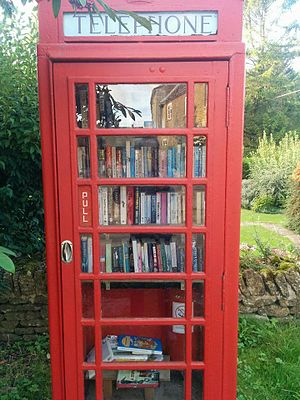 Little Rissington - A converted red phonebooth in Little Rissington which operates as an open library