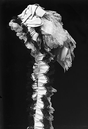 Bonnet (headgear) - A bonnet decorated with lace and tulle from the 1880s