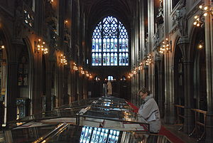 John Rylands - The historic reading room of the John Rylands library looking west (statue of John Rylands by John Cassidy in distance)