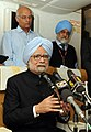 Manmohan Singh interacting with the accompanying media on board, on his way back to Delhi after attending the 68th Session of the United Nations General Assembly, in New York. The Deputy Chairman, Planning Commission (1).jpg