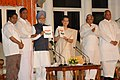 Manmohan Singh releasing 'Report to the People 2004-07' and giving a copy to the Chairperson, UPA, Smt. Sonia Gandhi on the occasion of Third anniversary of the UPA Government, in New Delhi on May 22, 2007 (2).jpg