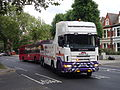 Mansfield Group truck (V8 REC) towing London United bus OV13, 20 May 2014 (1).jpg
