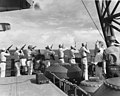 Marines on USS Honolulu (CL-48) fire salute at funeral services for USS Helena (CL-50) Battle of Kula Gulf casualty, July 1943 (80-G-54566).jpg