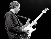 Mark Knopfler with Schecter Stratocaster, Amsterdam 1981.jpg