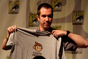 Stoopid Monkey - Matthew Senreich with a Stoopid Monkey shirt.