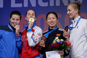 Women's sabre at the 2015 World Fencing Championships - From left to right, Cécilia Berder, Sofiya Velikaya, Shen Chen and Anna Márton