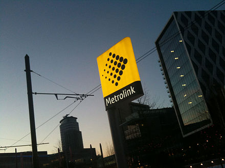 Metrolink stops are marked with yellow totems, such as this one at MediaCityUK Media city metrolink station2.jpg