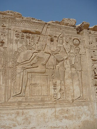 Theban Triad - The Theban Triad depicted at Medinet Habu. From left to right: Amun, Mut and Khonsu