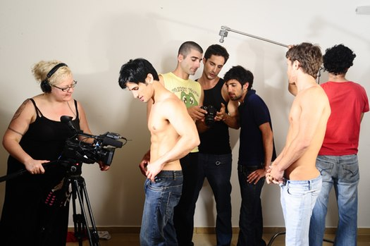 Photograph on the set of Lucas Entertainment's Men of Israel film shoot, with director Michael Lucas discussing the shoot with the cast. Michael Lucas Men of Israel film shoot.jpg