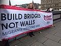 Migrants welcome here GJN banner (32421581195).jpg
