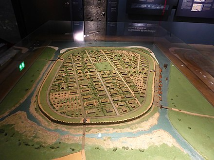 A typical fortified Viking town. This is a model of the town of Aros about 950. The town is now known as Aarhus Model of viking age Aarhus 02.JPG