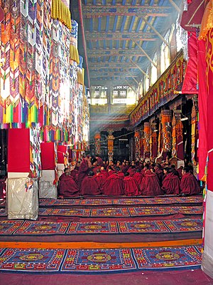 Drepung Monastery - Image: Monks in the great assembly hall at Drepung Monastery, Tibet