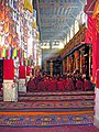 Monks in the great assembly hall at Drepung Monastery, Tibet.jpg