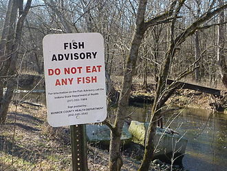"Clear Creek (Salt Creek) - ""Do not eat any fish"", a sign by the creek downstream of Dillman Road Wastewater Treatment Plant"