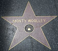 "Woolley's star on the Hollywood Walk of Fame, showing the television emblem, though his official category is ""Motion Pictures"""