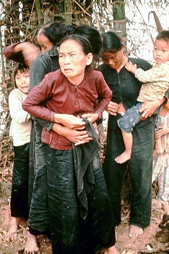 My Lai Massacre - South Vietnamese women and children in Mỹ Lai before being killed in the massacre, 16 March 1968. According to court testimony, they were killed seconds after the photo was taken. The woman on the right is adjusting her blouse buttons following a sexual assault that happened before the massacre.