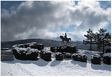 Photo of a statue of Napoleon overlooking a snow-covered scene