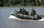 Members of U.S. Navy Seal Team One move down the Bassac River in a Seal team Assault Boat (STAB) during operations along the river south of Saigon, November 1967.