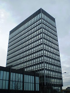 New Century House office building with an attached conference hall, in the NOMA district of Manchester, England