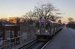 A Pink Line train traveling along 21st Street in Lawndale.