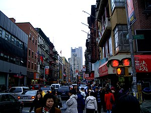 Crossing Canal Street in Chinatown, facing Mott Street toward the south