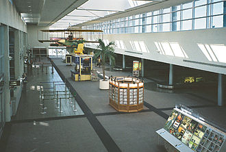 St. Pete–Clearwater International Airport - Baggage-claim area, with replica of Benoist XIV flying boat flown by aviation pioneer Tony Jannus in 1914 (2009 photo)