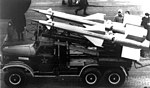 Pair of S-125 missiles in transit on a truck.jpg