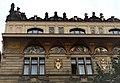 Palác čp.858-II palác Na Příkopě 18, Praha-Nové Město, fasáda 3. a 4. patra s mozaikami a atikou.jpg