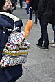 Paris French baguette travelling in an embroidered Portuguese backpack.jpg