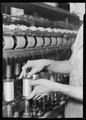 Paterson, New Jersey - Textiles. Rayon yarn being wound from one bobbin on to another and being twisted. - NARA - 518580.tif