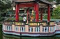 Pavilion and Buddha image within, Haw Par Villa (14607244240).jpg
