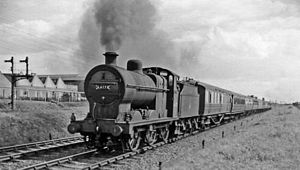 Syston and Peterborough Railway - A holiday express returning from the East Coast north of Peterborough in 1959