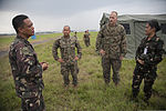 Philippine airmen and U.S. Marines with the aviation combat element of the 3rd Marine Expeditionary Brigade, III Marine Expeditionary Force discuss the air traffic navigation, integration and coordination system 131004-M-GX379-679.jpg