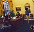Photograph of Chelsea Clinton Playing with Socks the Cat in the Oval Office While President William Jefferson Clinton Works at his Desk- 12-24-1994 (6461519327) (cropped).jpg