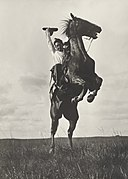 "Photographer Erwin E. Smith riding a ""sunfisher"" and he is not pulling leather, Bonham, Texas, 1908.jpg"