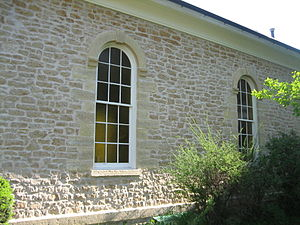 Plano Stone Church - The nine over nine round arch windows.